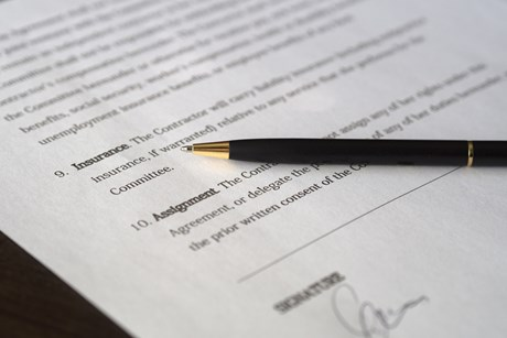 contract paperwork with pen