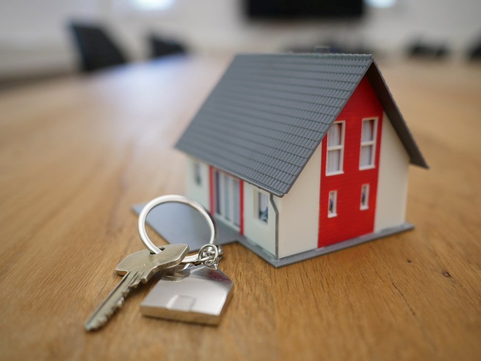 House keys and miniature model house